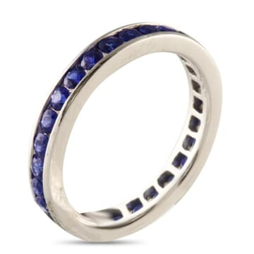 CHANNEL SET SAPPHIRE WHITE GOLD ETERNITY BAND