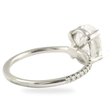 'MADE BY HAND' OVAL DIAMOND PLATINUM ENGAGEMENT RING