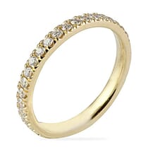 thin yellow gold wedding band with diamonds