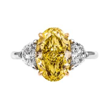 3.27 carat Oval Yellow Diamond Three-Stone ring