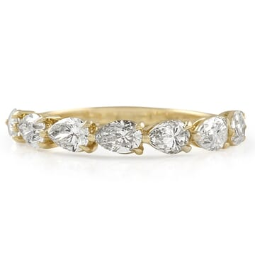EAST-WEST PEAR SHAPE DIAMOND HALFWAY BAND