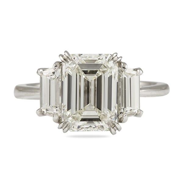 emerald cut diamond three stone trapezoid engagement ring