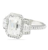 3.01 ct Emerald Cut Three-Stone Halo Engagement Ring