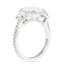 emerald cut three stone with halo design engagement ring