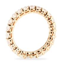 rose gold shared prong eternity band