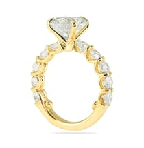 engagement ring in yellow gold with prong set diamonds band