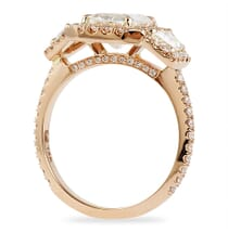 THREE STONE HALO ENGAGEMENT RING IN ROSE GOLD