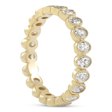 OVAL DIAMOND BEZEL SET YELLOW GOLD ETERNITY BAND