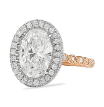 two tone halo engagement ring with bezel set band