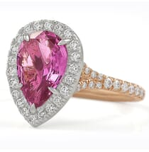 pink sapphire halo engagement ring with rose gold band
