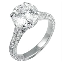 ROUND MOISSANITE ENGAGEMENT RING WITH THREE ROW BAND