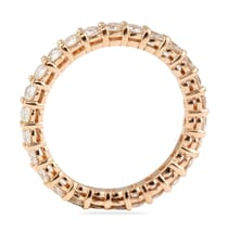 rose gold eternity band shared prong setting