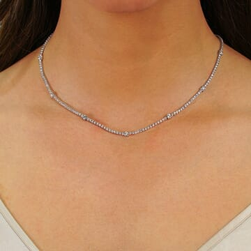 5.30 CT DIAMOND TENNIS NECKLACE WITH SEVEN LARGER STONES