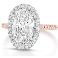 two-tone oval halo engagement ring with rose gold band