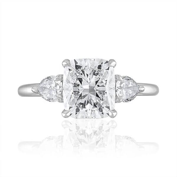 cushion cut diamond three stone ring pear side stone