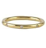 .10 CT ROUND DIAMOND BURNISHED SET YELLOW GOLD BAND