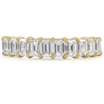emerald cut wedding band in yellow gold