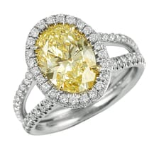 OVAL YELLOW DIAMOND HALO ENGAGEMENT RING WITH SPLIT BAND