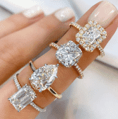 four various engagement ring styles on ladies hand