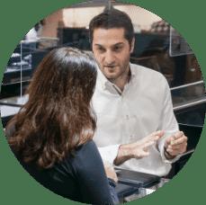 diamond design consultant assisting client jewelry showcase