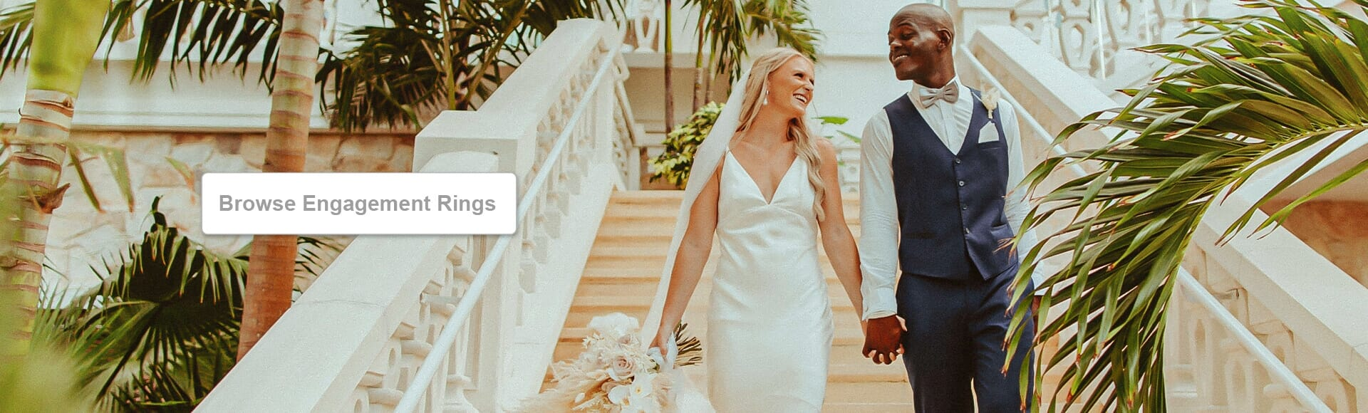 Newly wed couple walking down a staircase