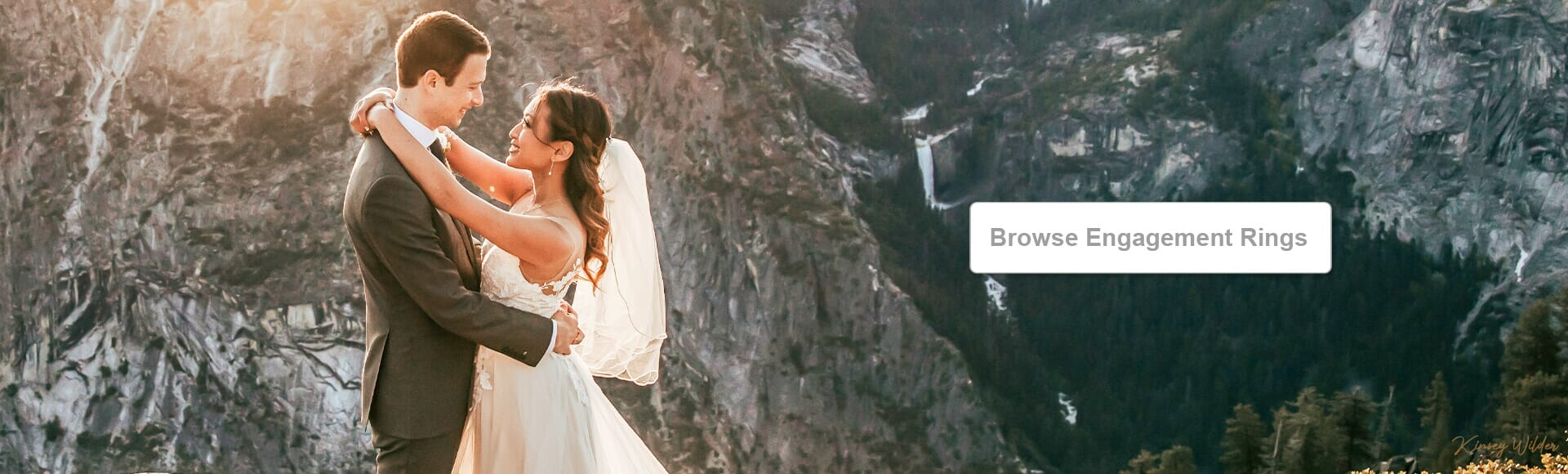 Newly wed couple surrounded by mountains