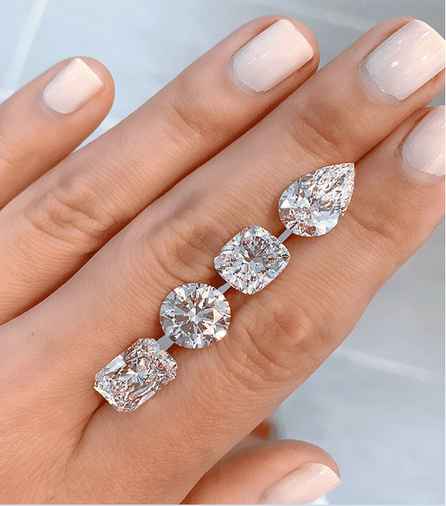 four diamond shapes resting on ladies hand radiant cut round cushion pear
