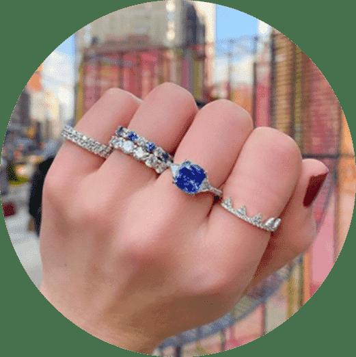 close-up view ladies hand sapphire diamond jewelry engagement rings