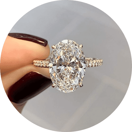 close-up view oval diamond engagement ring