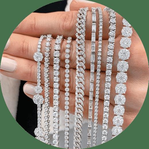lady hand holding diamond tennis bracelets